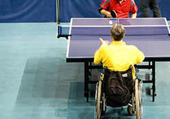 Two people playing table tennis.